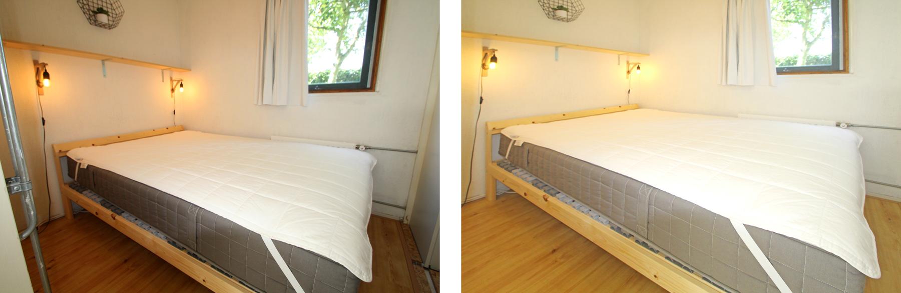 Blick auf Doppelbett im Schlafzimmer